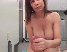 Alluring office babe loves stroking cock