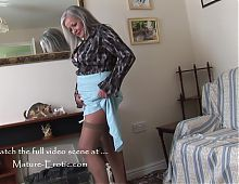 Busty mature babe April upskirt and striptease show