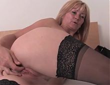 horny blonde milf in black stockings cums