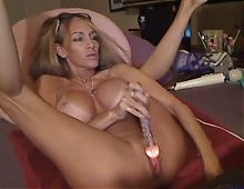 Tanned mature blonde fucks her pussy