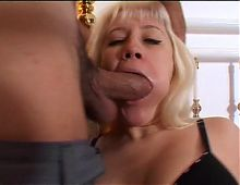Busty blond MILF deepthroats a thick Mediterranean cock then fucks