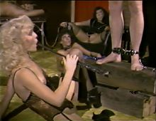 Bound guy in rubber mask gets whipped by hot blonde