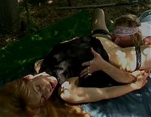 Cute blonde in black lingerie spreads her legs so dude can eat her cunt outdoors