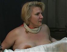 Poor mature blonde slave girl has her nipples tortured with small needles