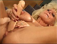 Horny ugly blonde plays with her pussy then licks her big dildo