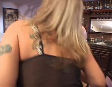 Sexy blonde gets her pussy licked on table by a hot chick