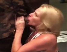 Name this Hot blonde MILF who is Giving Blowjob to BBC