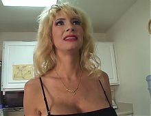 Mature blonde Tara Moon shows off humugous tits