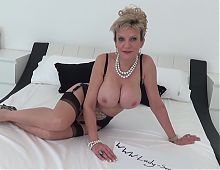 Mature British blonde Lady Sonia masturbating