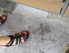 My wife's feet in heels at the tram station