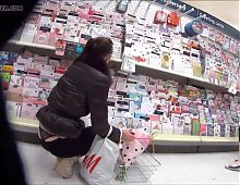 voyeur films a woman in a supermarket with the thong going o