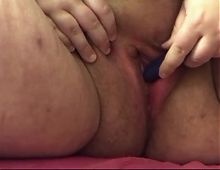 Amateur woman vibrates herself to orgasm