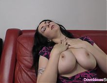 Brunette mature woman oiling up her lovely natural boobs