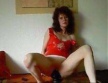 German milf sit on black cone dildo