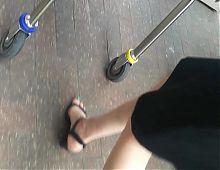Friends sexy feet in black sandals